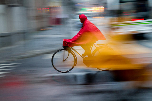 Panning: Capture Motion Blur and Keep your Subject in Focus by David Peterson. http://www.digital-photo-secrets.com/tip/4434/panning-motion-blur-subject-focus/